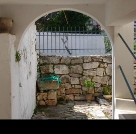Book accommodation on Ithaca, stone wall