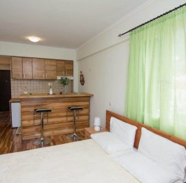 Rent accommodation on Ithaca, bedroom and kitchen